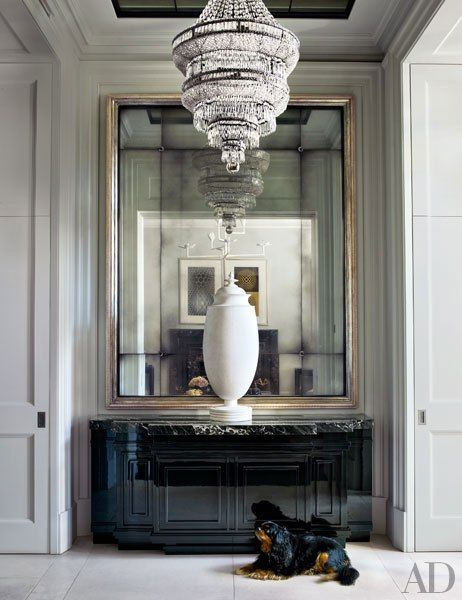 A 1940s plaster urn graces the entrance hall of a stately London townhouse by designer Hubert Zandberg