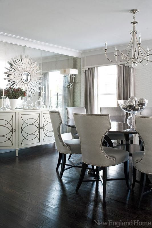 An elegant white decor for a dining room, with an 'ice castle' resemblance created by the mirrored wall.